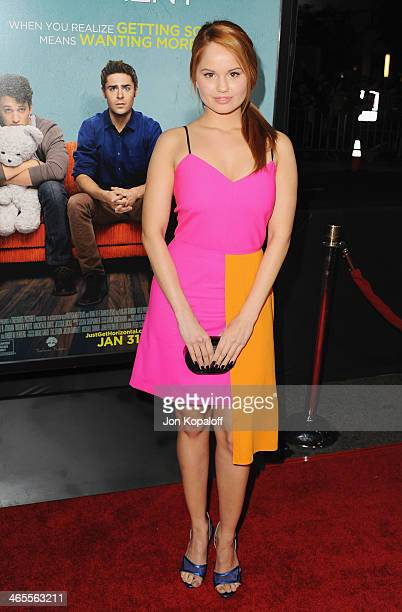 Actress Debby Ryan arrives at the Los Angeles Premiere 'That Awkward Moment' at Regal Cinemas LA Live on January 27 2014 in Los Angeles California