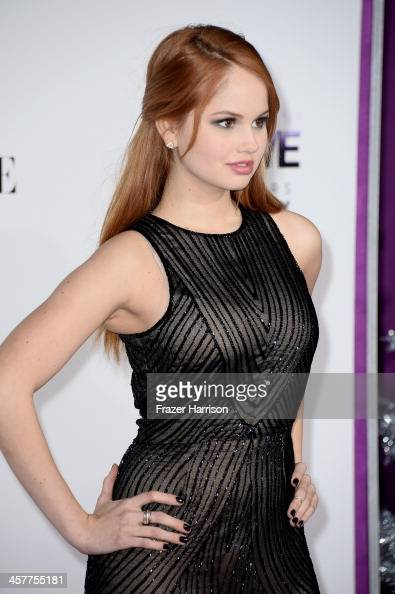 Actress Debby Ryan arrives at the premiere of Open Road Films' 'Justin Bieber's Believe' at Regal Cinemas LA Live on December 18 2013 in Los Angeles...