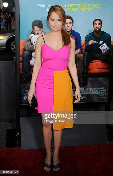 Actress Debby Ryan arrives to the Los Angeles premiere of 'That Awkward Moment' at Regal Cinemas LA Live on January 27 2014 in Los Angeles California