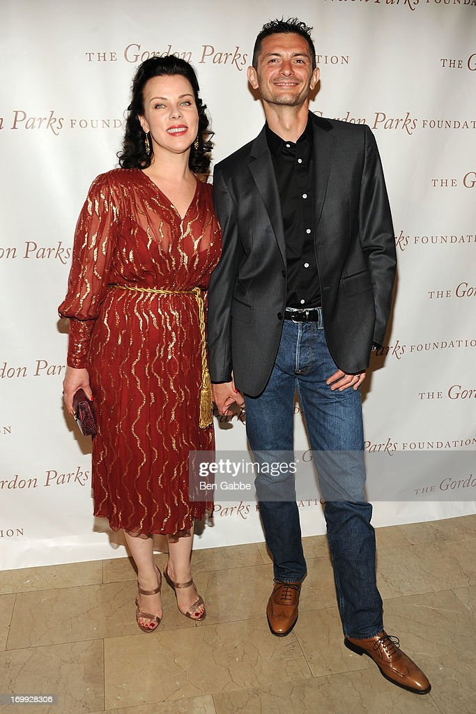 Actress <a gi-track='captionPersonalityLinkClicked' href=/galleries/search?phrase=Debi+Mazar&family=editorial&specificpeople=212937 ng-click='$event.stopPropagation()'>Debi Mazar</a> and husband <a gi-track='captionPersonalityLinkClicked' href=/galleries/search?phrase=Gabriele+Corcos&family=editorial&specificpeople=599315 ng-click='$event.stopPropagation()'>Gabriele Corcos</a> attend 2013 Gordon Parks Foundation Awards at The Plaza Hotel on June 4, 2013 in New York City.