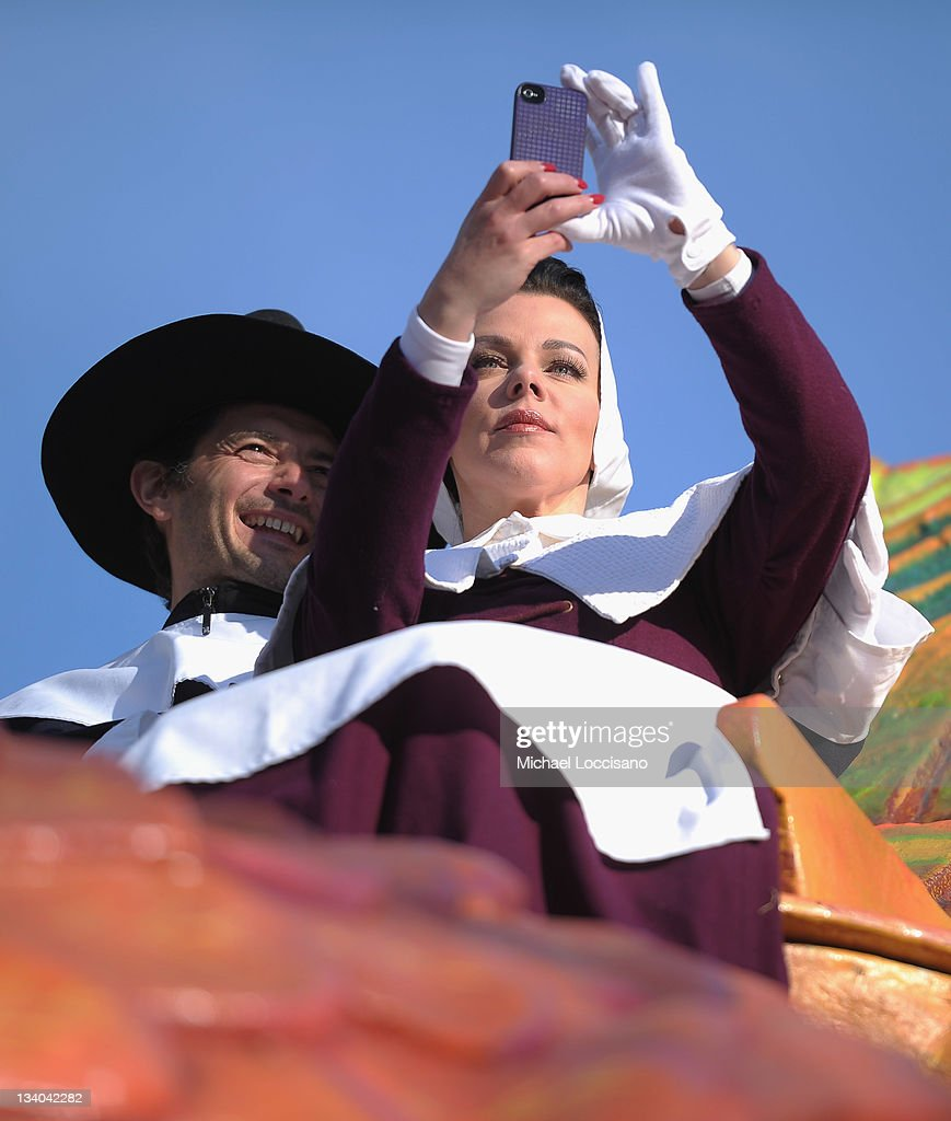 Actress <a gi-track='captionPersonalityLinkClicked' href=/galleries/search?phrase=Debi+Mazar&family=editorial&specificpeople=212937 ng-click='$event.stopPropagation()'>Debi Mazar</a> (R) and husband <a gi-track='captionPersonalityLinkClicked' href=/galleries/search?phrase=Gabriele+Corcos&family=editorial&specificpeople=599315 ng-click='$event.stopPropagation()'>Gabriele Corcos</a> take a picture of themselves atop a turkey float during the 85th Annual Macy's Thanksgiving Day Parade on November 24, 2011 in New York City.