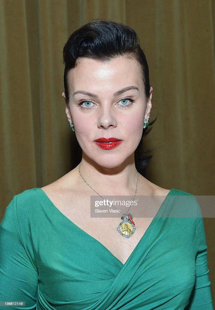 Actress <a gi-track='captionPersonalityLinkClicked' href=/galleries/search?phrase=Debi+Mazar&family=editorial&specificpeople=212937 ng-click='$event.stopPropagation()'>Debi Mazar</a> volunteers during the Our Table Is Yours - A Thanksgiving Day benefit at Cipriani, Wall Street on November 21, 2012 in New York City.