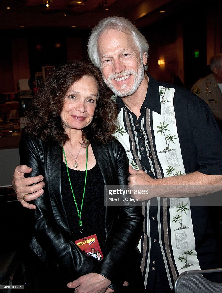 Actress Deborah Van Valkenburgh and Michael Beck reunite for 'The Warriors' at The Hollywood Show at Lowes Hollywood Hotel on January 4, 2014 in Hollywood, California.