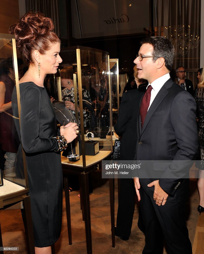 Actress <a gi-track='captionPersonalityLinkClicked' href=/galleries/search?phrase=Debra+Messing&family=editorial&specificpeople=202114 ng-click='$event.stopPropagation()'>Debra Messing</a> (L) and Cartier director of image, style, and heritage Pierre Rainero attend the Rodeo Drive Walk Of Style held at the Cartier Boutique on October 22, 2009 in Beverly Hills, California.