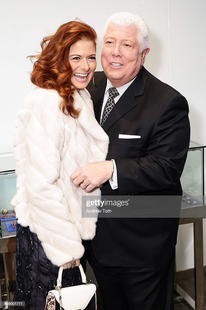 Actress <a gi-track='captionPersonalityLinkClicked' href=/galleries/search?phrase=Debra+Messing&family=editorial&specificpeople=202114 ng-click='$event.stopPropagation()'>Debra Messing</a> (L) and designer Dennis Basso attend the Dennis Basso Store Opening at Dennis Basso Store on December 10, 2013 in New York City.