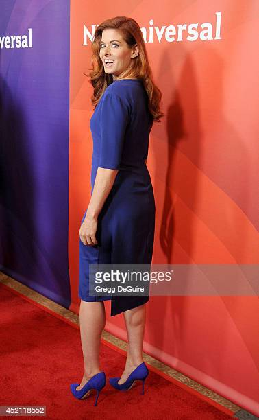 Actress Debra Messing arrives at the 2014 Television Critics Association Summer Press Tour NBCUniversal Day 1 at The Beverly Hilton Hotel on July 13...