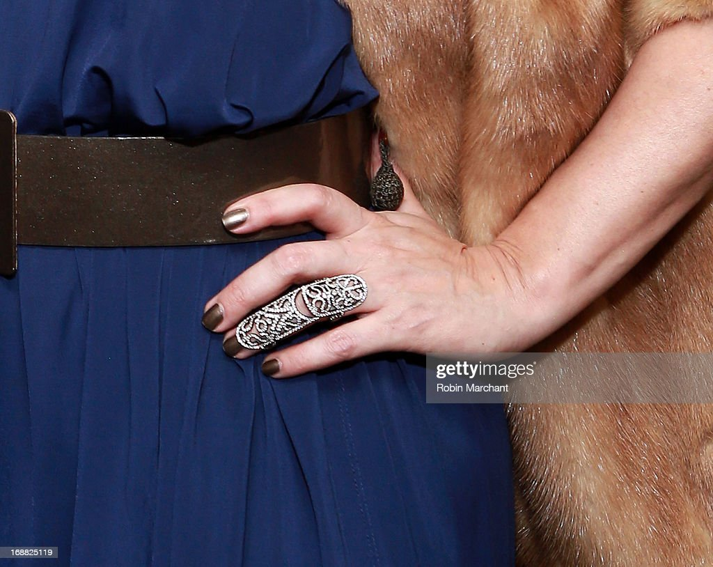 Actress <a gi-track='captionPersonalityLinkClicked' href=/galleries/search?phrase=Debra+Messing&family=editorial&specificpeople=202114 ng-click='$event.stopPropagation()'>Debra Messing</a> (ring detail) attends 'Toast Around The World' Celebration at New York Sheraton Hotel & Tower on May 15, 2013 in New York City.