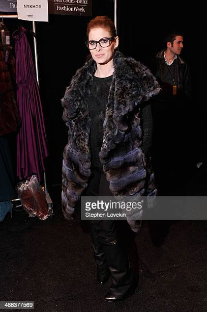 Actress Debra Messing poses backstage at the Dennis Basso fashion show during MercedesBenz Fashion Week Fall 2014 at The Theatre at Lincoln Center on...