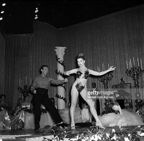 Actress Debra Paget performs at the Debutante Star Ball in Los AngelesCA
