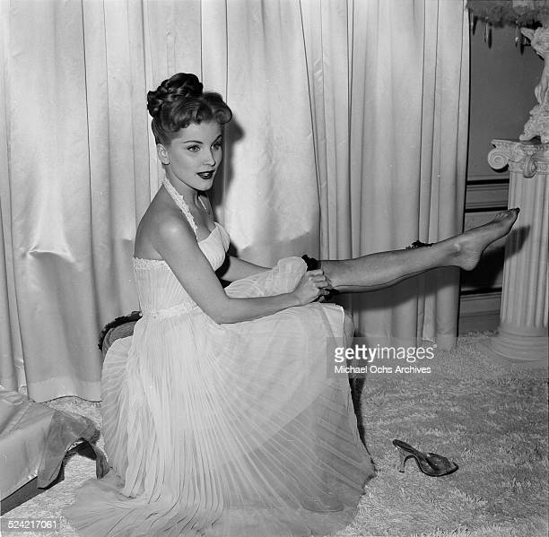 Actress Debra Paget poses in stockings in Los AngelesCA