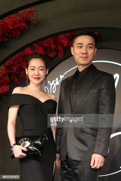 Actress Dee Hsu and her husband Mike Hsu arrive at the red carpet of the banquet held by Macau businessman Levo Chan and actress Ady An on June 23...