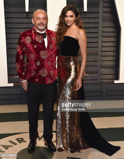 Actress Deepika Padukone and Christian Louboutin arrive at the 2017 Vanity Fair Oscar Party Hosted By Graydon Carter at Wallis Annenberg Center for...