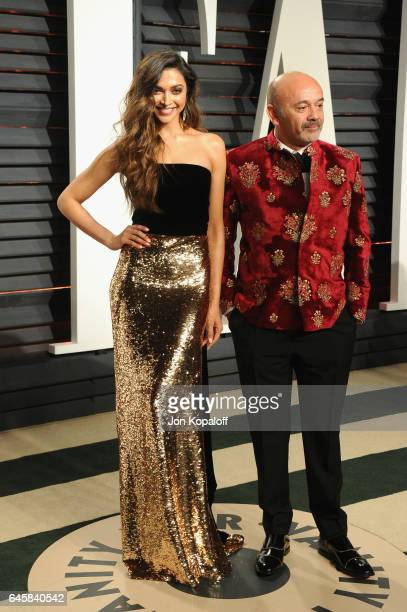 Actress Deepika Padukone and designer Christian Louboutin attend the 2017 Vanity Fair Oscar Party hosted by Graydon Carter at Wallis Annenberg Center...