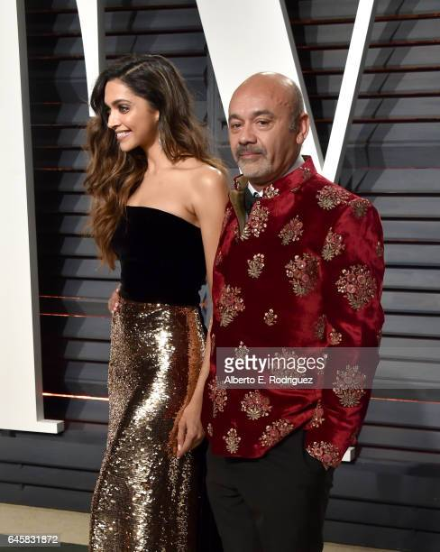 Actress Deepika Padukone and fashion designer Christian Louboutin attend the 2017 Vanity Fair Oscar Party hosted by Graydon Carter at Wallis...