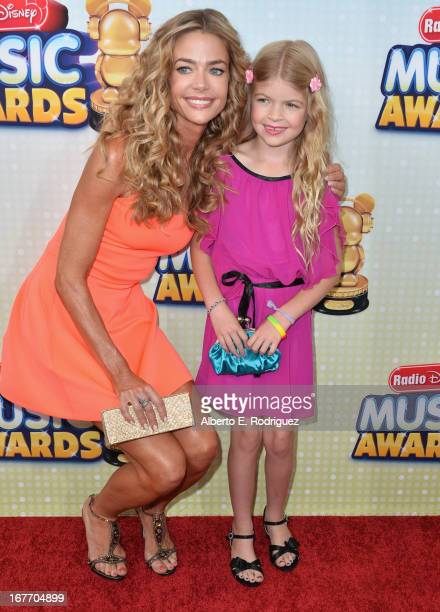 Actress Deinse Richards and daughter Lola Sheen arrive to the 2013 Radio Disney Music Awards at Nokia Theatre LA Live on April 27 2013 in Los Angeles...