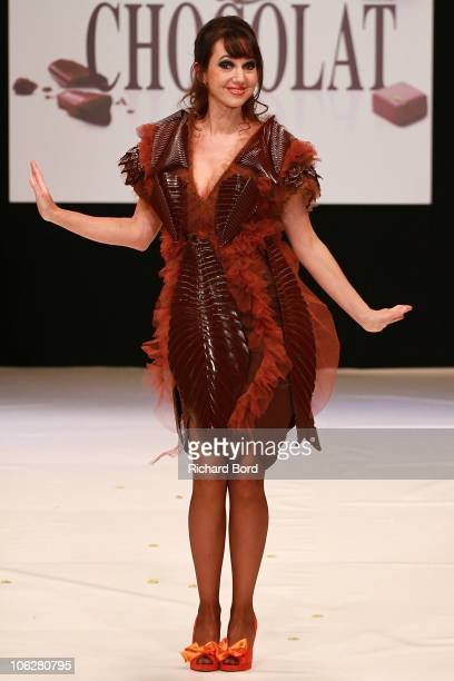 Actress Delphine Mc Carty dressed by Jacques Bellanger and Moda Fusion walks the runway at the Salon Du Chocolat 2010 Opening Night at the Parc des...