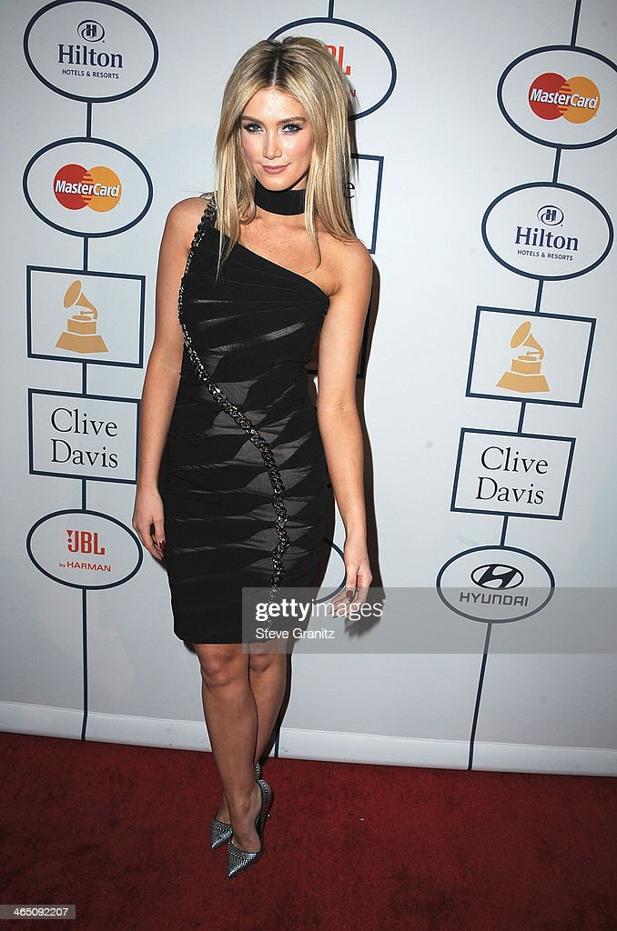 Actress <a gi-track='captionPersonalityLinkClicked' href=/galleries/search?phrase=Delta+Goodrem&family=editorial&specificpeople=201895 ng-click='$event.stopPropagation()'>Delta Goodrem</a> attends the 56th annual GRAMMY Awards Pre-GRAMMY Gala and Salute to Industry Icons honoring Lucian Grainge at The Beverly Hilton on January 25, 2014 in Los Angeles, California.