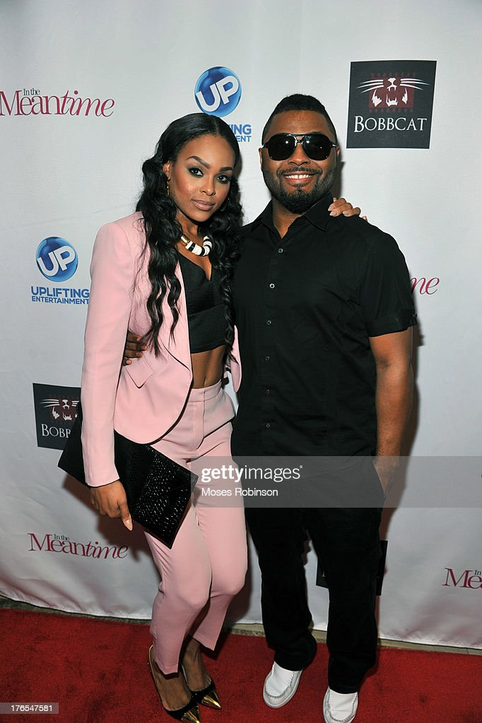 Actress Demetria McKinney and recording artist/actor Music Soulchild attend the premiere of 'In the Meantime' at the Woodruff Arts Center on August 14, 2013 in Atlanta, Georgia.