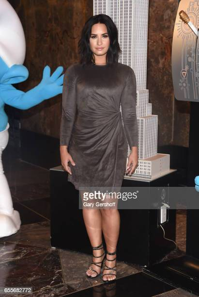 Actress Demi Lovato visits The Empire State Building to celebrate the 'Small Surfs Big Goals' campaign and the International Day Of Happiness at The...