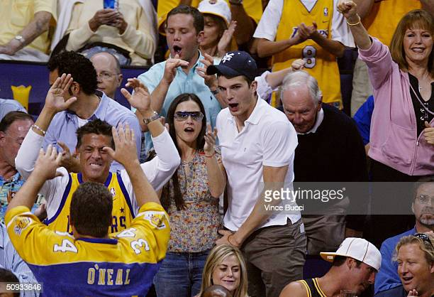 Actress Demi Moore and boyfriend/actor Ashton Kutcher attend game one of the 2004 NBA Finals between the Detroit Pistons and the Los Angeles Lakers...
