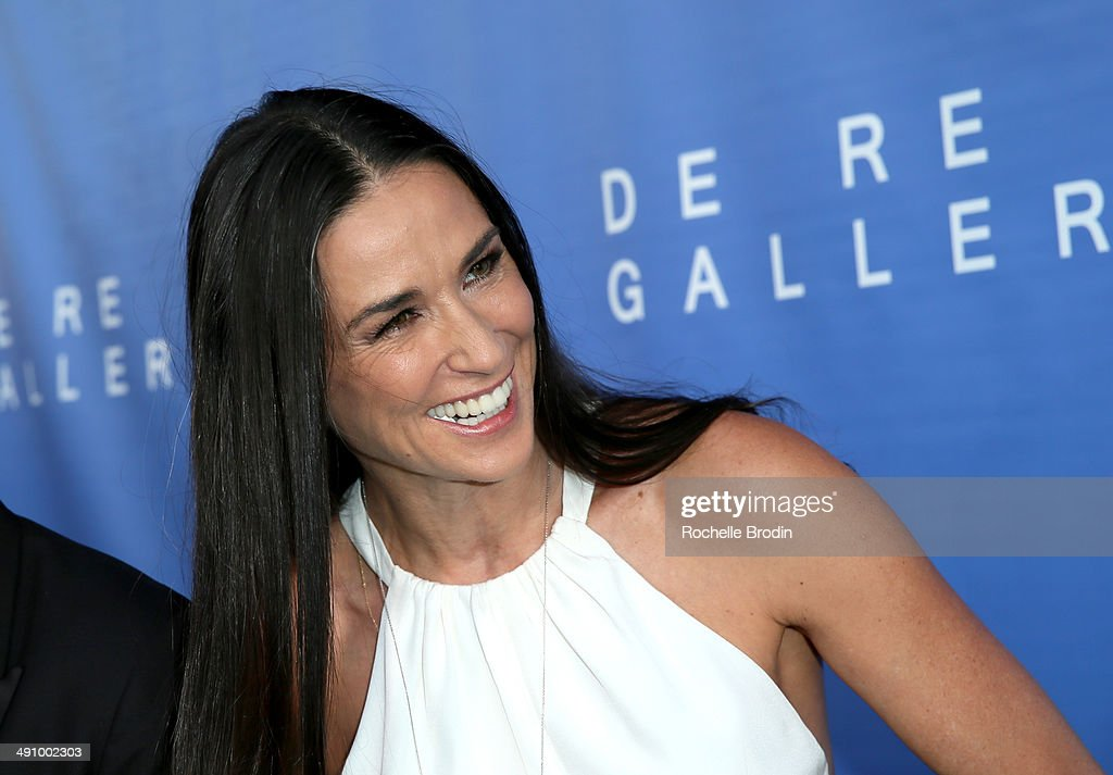Actress <a gi-track='captionPersonalityLinkClicked' href=/galleries/search?phrase=Demi+Moore&family=editorial&specificpeople=202121 ng-click='$event.stopPropagation()'>Demi Moore</a> attends the grand opening of De Re Gallery on May 15, 2014 in West Hollywood, CA.