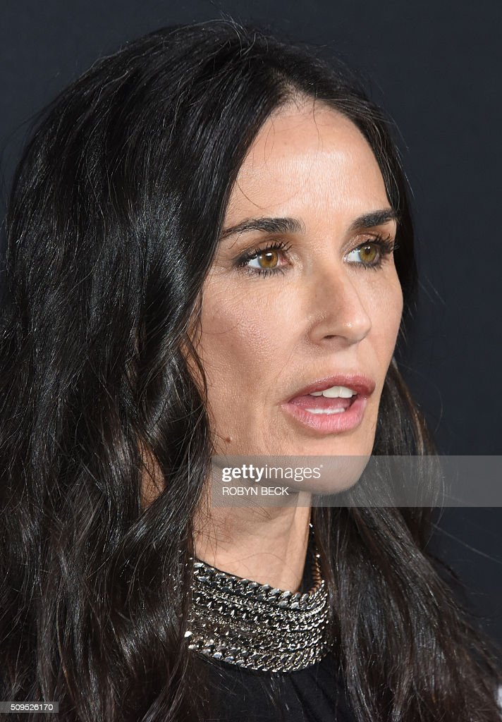 Actress Demi Moore attends the Saint Laurent men's fall line and the first part of its women's collection fashion show at the Paladium, in Hollywood, California, February 10, 2016. / AFP / ROBYN BECK