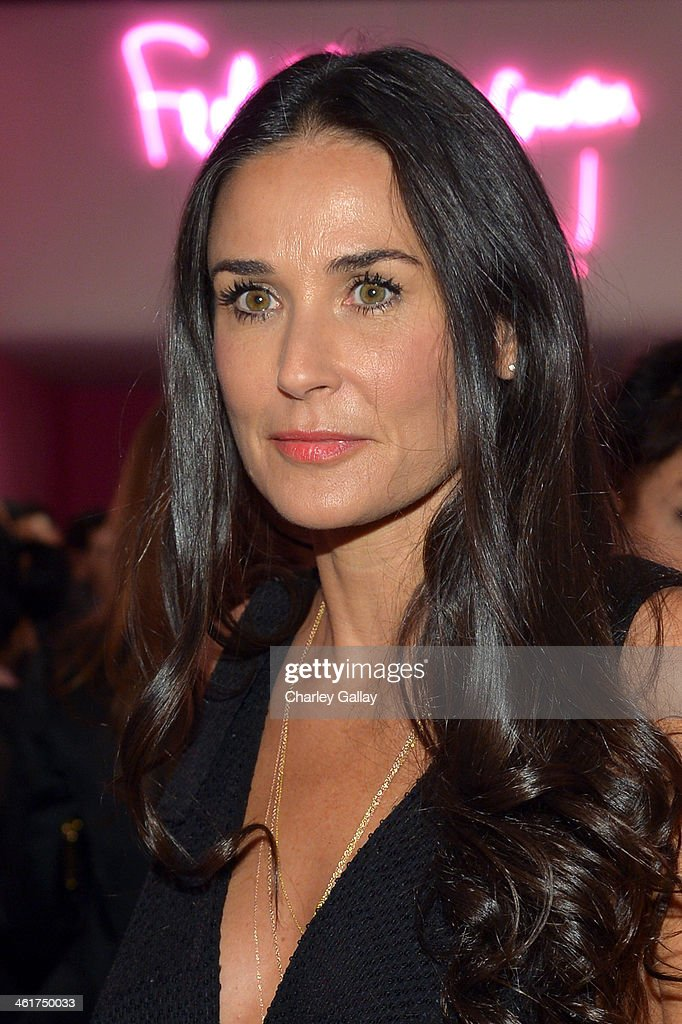 Actress Demi Moore, wearing Diane Von Furstenberg, attends Diane Von Furstenberg's Journey of A Dress Exhibition Opening Celebration at May Company Building at LACMA West on January 10, 2014 in Los Angeles, California.
