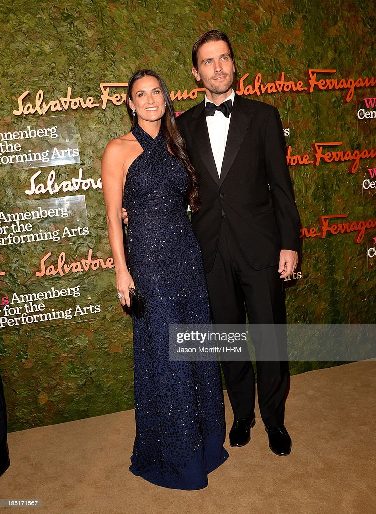 Actress <a gi-track='captionPersonalityLinkClicked' href=/galleries/search?phrase=Demi+Moore&family=editorial&specificpeople=202121 ng-click='$event.stopPropagation()'>Demi Moore</a>, wearing Ferragamo, and <a gi-track='captionPersonalityLinkClicked' href=/galleries/search?phrase=James+Ferragamo&family=editorial&specificpeople=3951748 ng-click='$event.stopPropagation()'>James Ferragamo</a> arrive at the Wallis Annenberg Center for the Performing Arts Inaugural Gala presented by Salvatore Ferragamo at the Wallis Annenberg Center for the Performing Arts on October 17, 2013 in Beverly Hills, California.