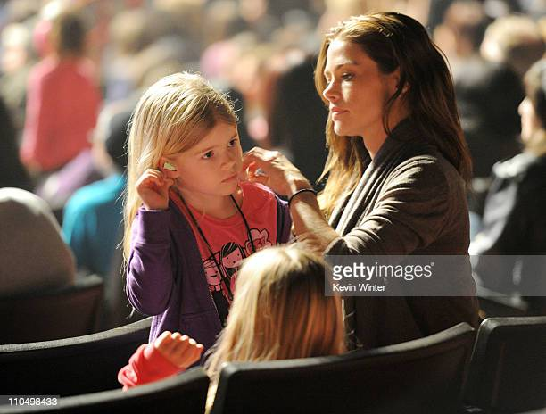 Actress Denise Richards with daughter Lola puts earplugs in her daughter Sam's ears at the 3rd Annual 'Concert for Hope' presented by Staples at the...