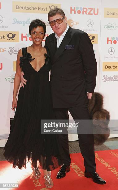 Actress Dennenesch Zoude and director Carlo Rola arrive for the Goldene Kamera Awards at the Axel Springer building February 2 2006 in Berlin Germany