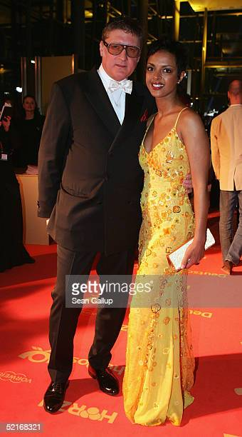 Actress Dennenesch Zoude and friend Carlo Rola arrive at the 'Goldene Kamera' Awards at Axel Springer House on February 9 2005 in Berlin Germany