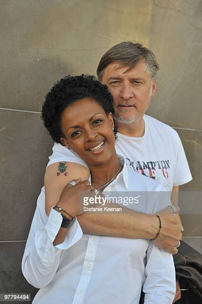 Actress Dennenesch Zoude and husband director Carlo Rola pose for the photographer during their honeymoon on October 23 2009 in Los Angeles California