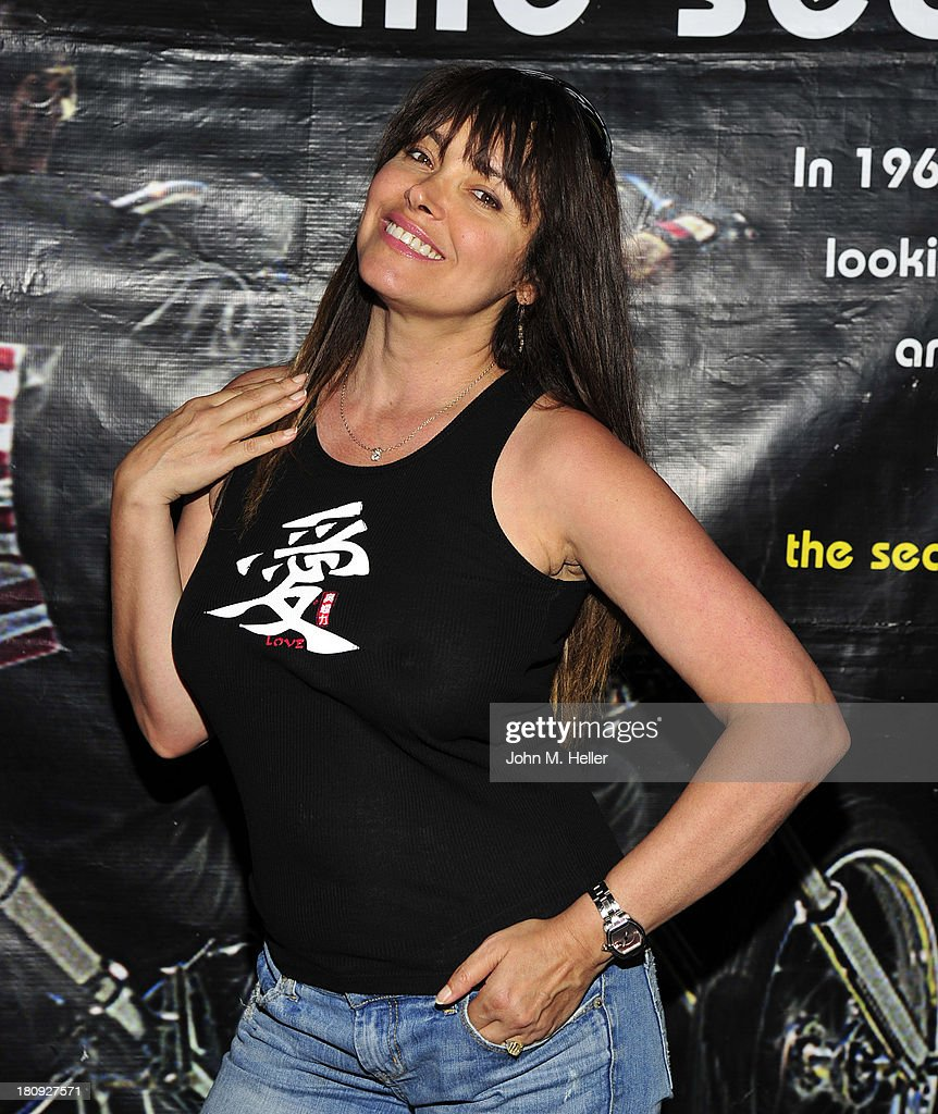 Actress <a gi-track='captionPersonalityLinkClicked' href=/galleries/search?phrase=Devin+DeVasquez&family=editorial&specificpeople=675343 ng-click='$event.stopPropagation()'>Devin DeVasquez</a> attends the premiere of 'Easy Rider The Ride Back' Ride-In at Bartels' Harley-Davidson on September 17, 2013 in Marina del Rey, California.
