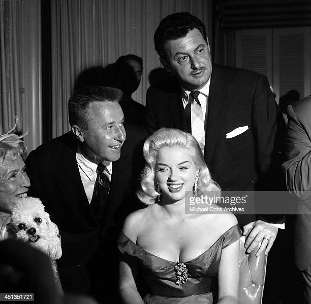 Actress Diana Dors attends a cocktail party with George Gobel and Harold Kanter in Los Angeles California