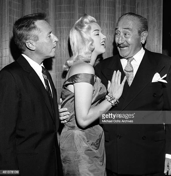 Actress Diana Dors attends a cocktail party with George Gobel and Adolphe Menjou in Los Angeles California