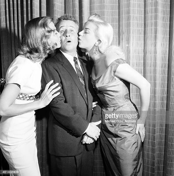 Actress Diana Dors attends a cocktail party with George Gobel and Rita Talbot in Los Angeles California