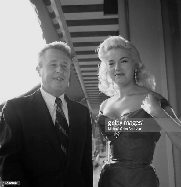 Actress Diana Dors poses with George Gobel before her cocktail party in Los Angeles California