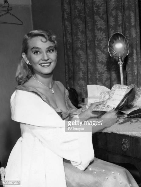 Actress Diane Cilento reading telegrams of congratulation in her dressing room at the Duke of York's Theatre London after signing a contract with Sir...