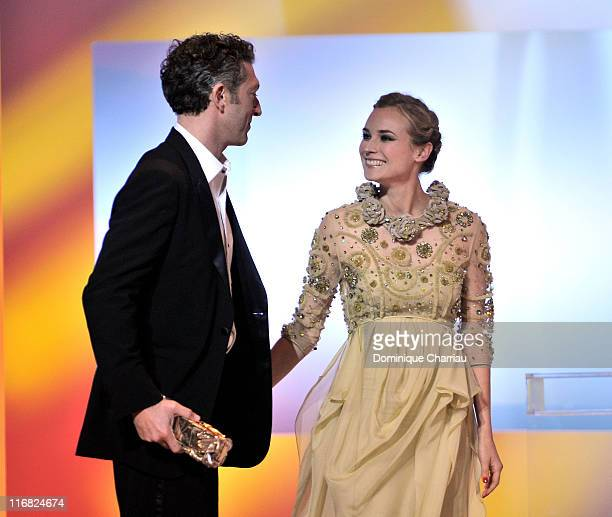 Actress Diane Kruger and actor Vincent Cassel as he receives a Cesar Award during the show the show at the Cesar Film Awards held at the Chatelet...