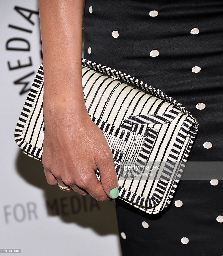 actress <a gi-track='captionPersonalityLinkClicked' href=/galleries/search?phrase=Diane+Kruger&family=editorial&specificpeople=202640 ng-click='$event.stopPropagation()'>Diane Kruger</a> (clutch detail) arrives at The Paley Center for Media's premiere screening of FX's 'The Bridge' at The Paley Center for Media on June 24, 2014 in Beverly Hills, California.