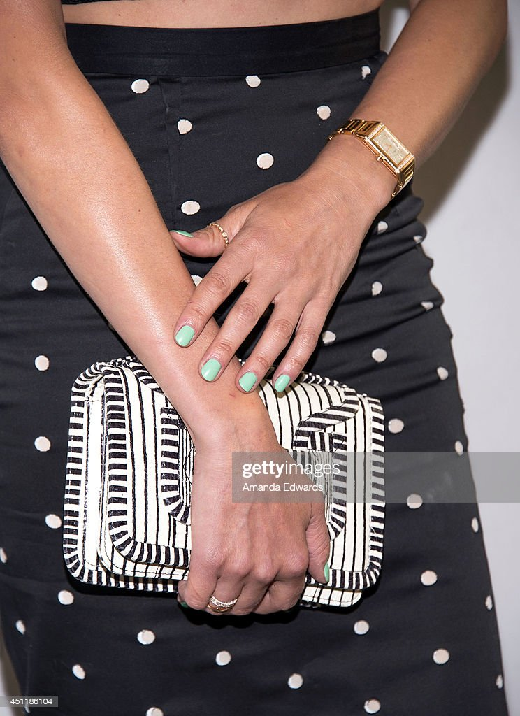 Actress Diane Kruger (clutch, watch and manicure detail) arrives at The Paley Center for Media's premiere screening of FX's 'The Bridge' at The Paley Center for Media on June 24, 2014 in Beverly Hills, California.