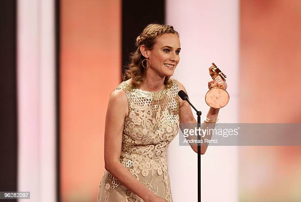 Actress Diane Kruger recieves the award for 'Best Actress International' from designer Karl Lagerfeld during the Goldene Kamera 2010 Award at the...