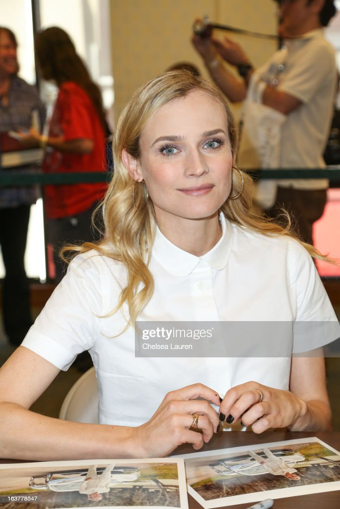 Actress <a gi-track='captionPersonalityLinkClicked' href=/galleries/search?phrase=Diane+Kruger&family=editorial&specificpeople=202640 ng-click='$event.stopPropagation()'>Diane Kruger</a> signs autographs for fans at the celebration of the film release of 'The Host' at Barnes & Noble bookstore at The Grove on March 15, 2013 in Los Angeles, California.