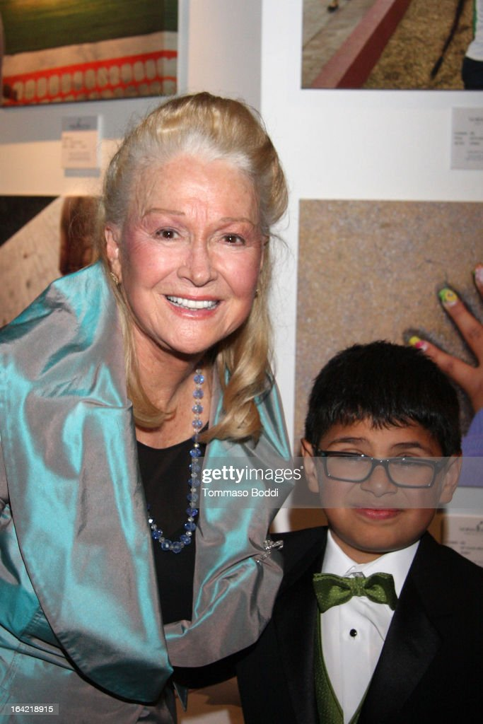 Actress <a gi-track='captionPersonalityLinkClicked' href=/galleries/search?phrase=Diane+Ladd&family=editorial&specificpeople=226819 ng-click='$event.stopPropagation()'>Diane Ladd</a> poses with one of the children of Hollygrove at the 1st Annual Norma Jean Gala held at the TCL Chinese Theatre on March 20, 2013 in Hollywood, California.