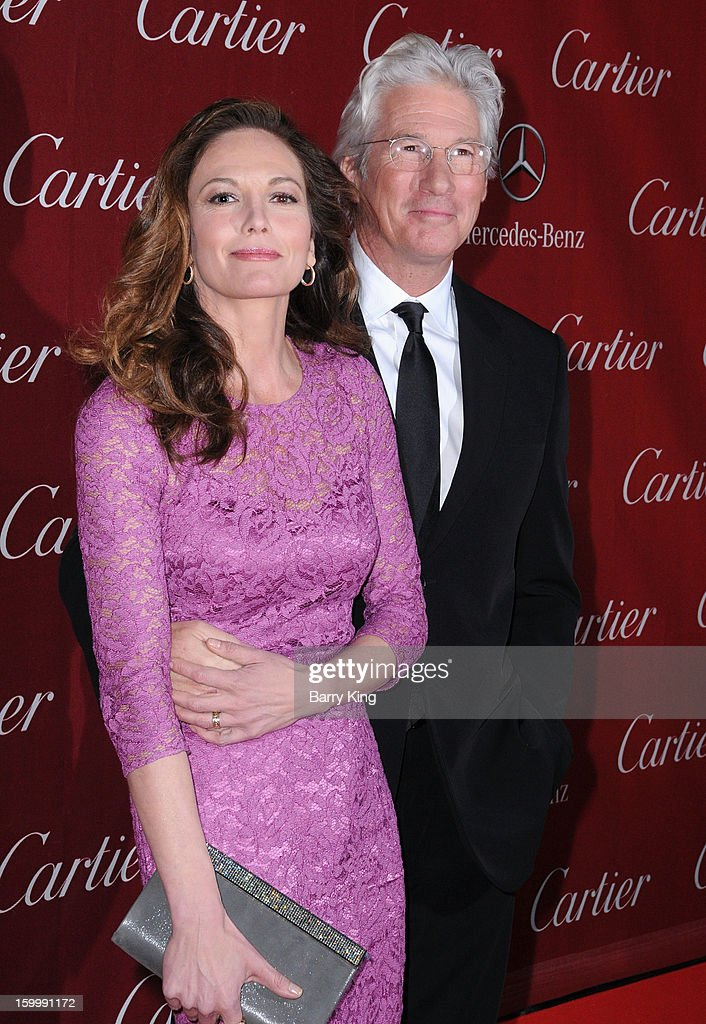 Actress <a gi-track='captionPersonalityLinkClicked' href=/galleries/search?phrase=Diane+Lane&family=editorial&specificpeople=206364 ng-click='$event.stopPropagation()'>Diane Lane</a> and actor <a gi-track='captionPersonalityLinkClicked' href=/galleries/search?phrase=Richard+Gere&family=editorial&specificpeople=202110 ng-click='$event.stopPropagation()'>Richard Gere</a> arrive at the 24th Annual Palm Springs International Film Festival Awards Gala at Palm Springs Convention Center on January 5, 2013 in Palm Springs, California.