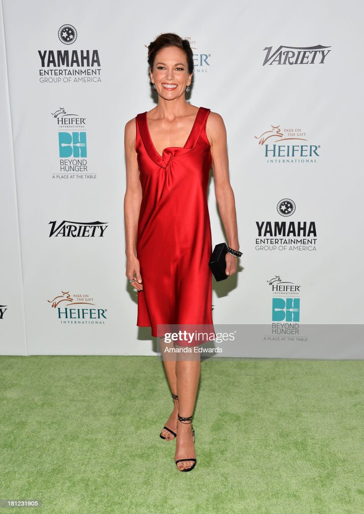 Actress <a gi-track='captionPersonalityLinkClicked' href=/galleries/search?phrase=Diane+Lane&family=editorial&specificpeople=206364 ng-click='$event.stopPropagation()'>Diane Lane</a> arrives at the 2nd Annual Beyond Hunger: A Place At The Table Benefit Honoring Susan Sarandon at Montage Beverly Hills on September 19, 2013 in Beverly Hills, California.