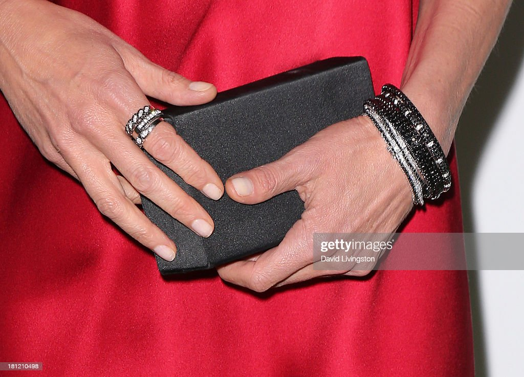 Actress Diane Lane (purse & jewelry detail) attends Heifer International's 'Beyond Hunger: A Place at the Table' gala at Montage Beverly Hills on September 19, 2013 in Beverly Hills, California.