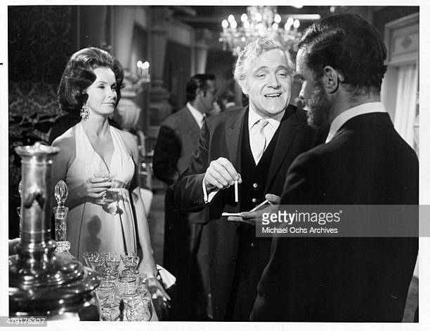 Actress Dina Merrill actor Sandor Szabo and Cliff Robertson in a scene from the movie 'The Sunshine Patriot' circa 1968