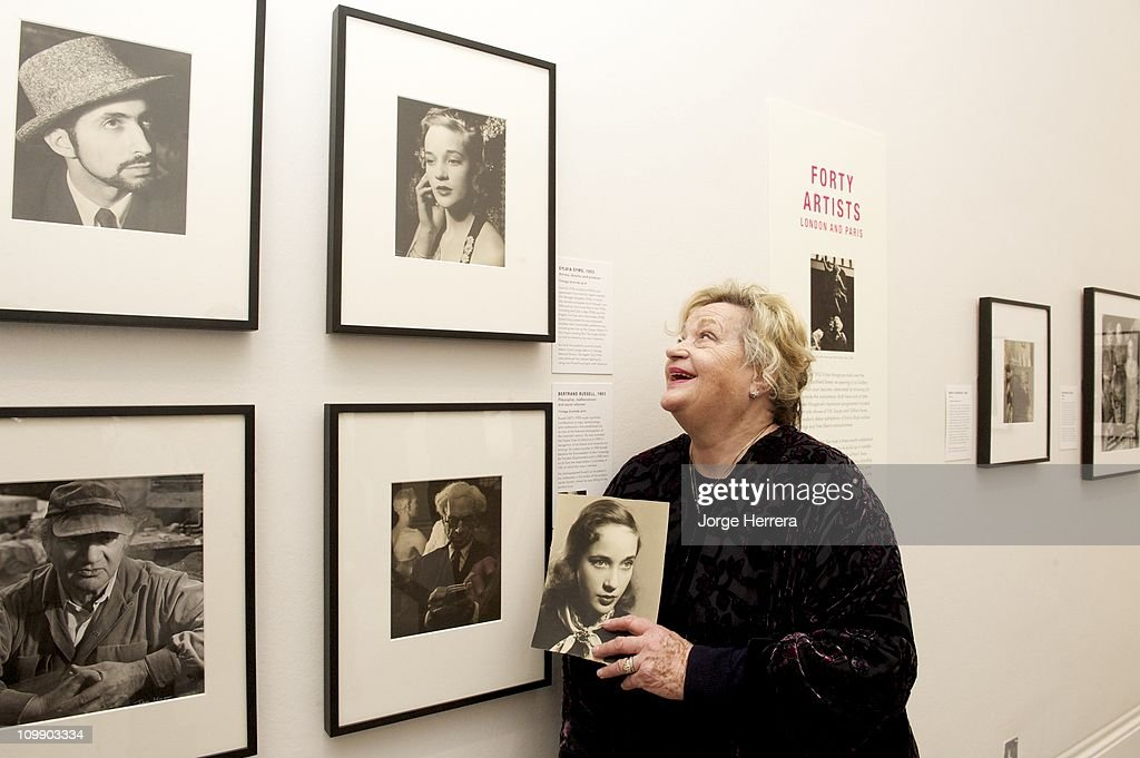 Actress, director and producer <a gi-track='captionPersonalityLinkClicked' href=/galleries/search?phrase=Sylvia+Syms&family=editorial&specificpeople=235776 ng-click='$event.stopPropagation()'>Sylvia Syms</a> poses next to her portrait by Ida Kar during the private view of 'Ida Kar: Bohemian Photographer, 1952-68' at the National Portrait Gallery on March 9, 2011 in London, England.