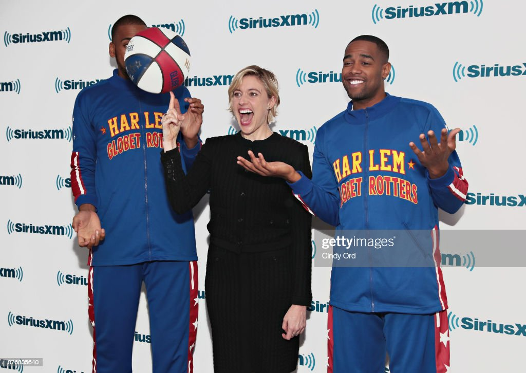 Actress/ director Greta Gerwig practices her basketball moves with Juilan 'Zeus' McClurkin and Brawley 'Cheese' Chisholm of the Harlem Globetrotters during a visit to the SiriusXM Studios on November 20, 2017 in New York City.
